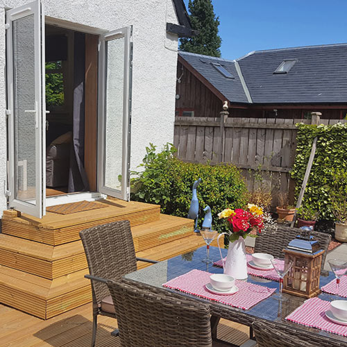 Garden room outside decking and dinning table