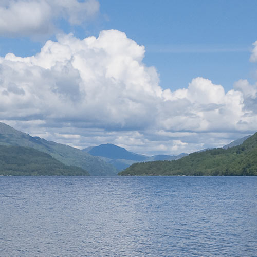 Loch Lomond with blue sky and clouds